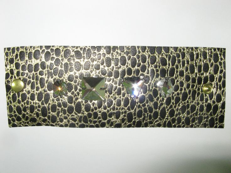 Leather cuff (1 pc)  Made with embossed black/gold leather and swarovski crystals.
