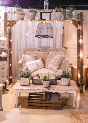 Old vintage ladders surrounded by fairy lights frame a beautiful antique sofa at the City Farmhouse Pop Up Fair | June 2017 | Franklin, TN