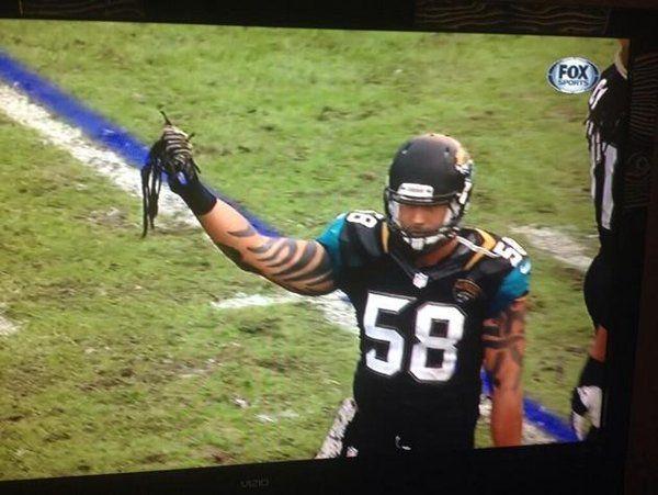 Arizona's Andre Ellington gets some dreadlocks ripped out by Jacksonville end Jason Babin