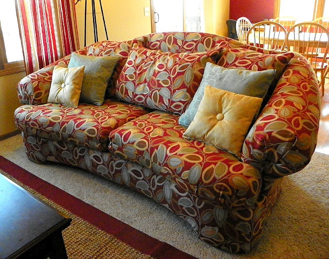 DIY couch covering with staple gun, leave on old fabric. Will totally need this for when I cover the parlor's couch.