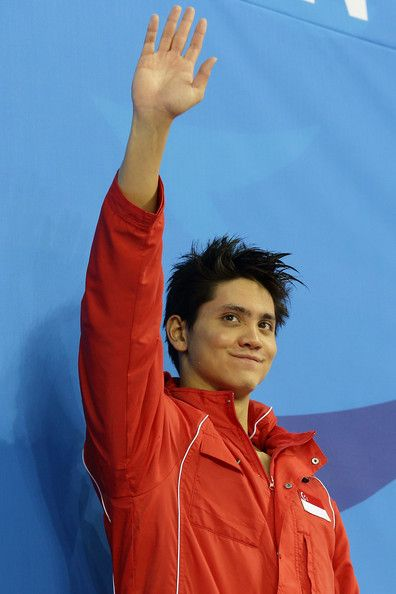 Joseph Schooling Photos - Joseph Schooling of Singapore wins the gold medal in the menÕs 100m butterfly final  on day five of 2014 Asian Games at Munhak Park Tae-hwan Aquatics Center on September 23, 2014 in Incheon, South Korea. - Asian Games: Day 5