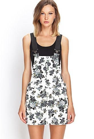 This denim overall dress features a soft floral print and elasticized shoulder straps with a hook closure.  http://foxyblu.com/products/details/141613