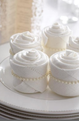 Very cute napkins - roll up like cup cakes and place ring of pearls around them. How perfect for a bridal shower?!