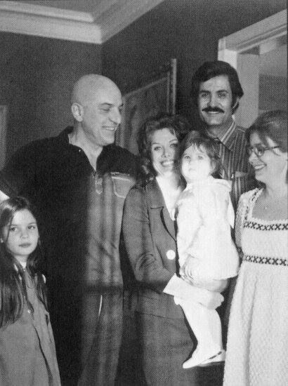 Little Jennifer Aniston in the arms of her mom, Nancy Dow, with dad John Aniston and Jen's godfather, Telly Savalas