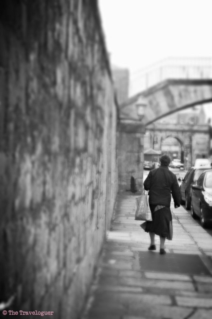 Woman walking in Dublin City Centre. Monochrome Monday - a series of travel photography from around the world - in black and white thetraveloguer.com