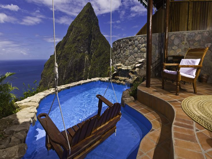 A swing over the pool so you can just dip your feet in...Love it!  I would do it so it could be moved for swimming too