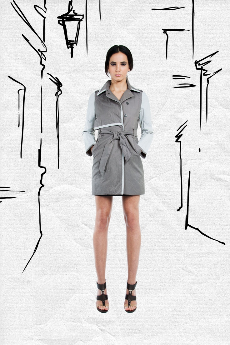 JAC Spring 2013. This trench is a statement of its own! Roll up the sleeves and wear it as a dress with a short chunky chain necklace under the collar.