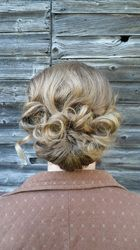 #Bridal and #bridesmaid #hairstyles by Allene Chomyn Hair Design.  Romantic loose #curls in a low #chignon.