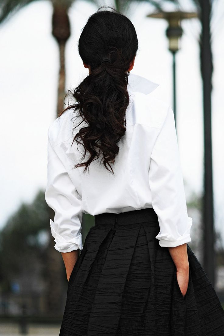 Crisp white shirt (from Costco, says the blogger's notes; #fashioneverywhere) tucked into a sweeping black skirt.