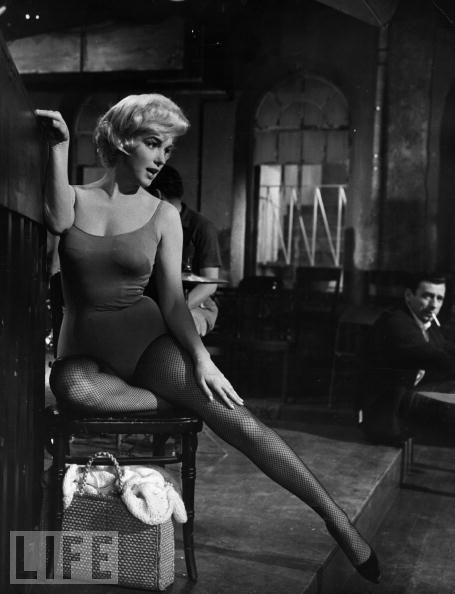 """Yves Montand Keeps an Eye on Marilyn Monroe  Montand watches Monroe on the set of their poorly received 1960 musical comedy """"Let's Make Love."""" During the shoot, the two stars, both married to others, would have a brief affair."""