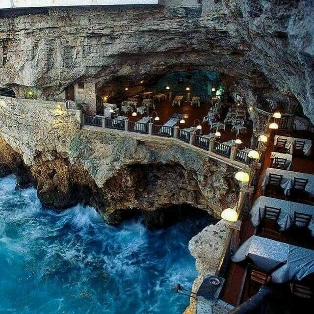 Italy – The Cliff Restaurant (Grotta Palazzese) was built in a cave in the region of Apulia, Italy.
