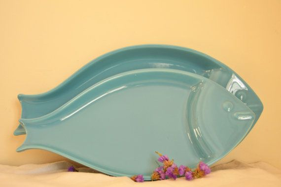 Set of 2 fish shaped dishes in turquoise blue.