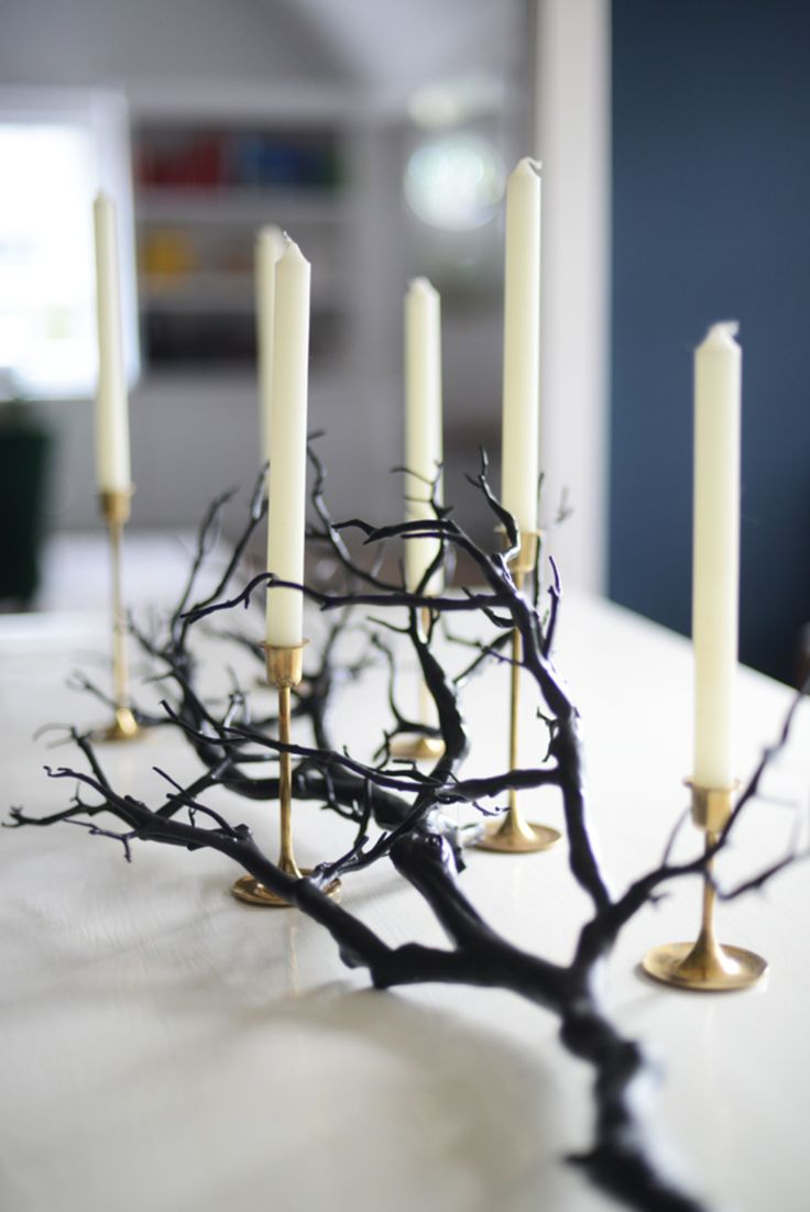 Simple and elegant Halloween branch centerpiece  {Branch with candles on the dining room table}