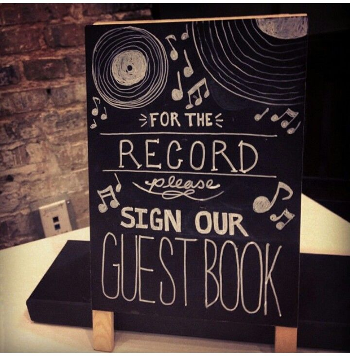 Doctor who wedding/ video tape wedding: our guest book wasn't really Doctor Who themed, but it was vintage. Guests signed old vinyl records.