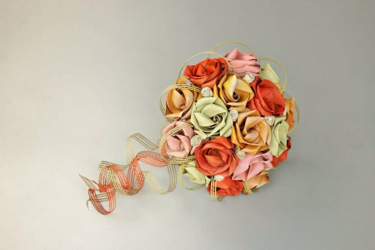 Large brides bouquet in tangerine, yellow, pale pink and pale sage with tiny ivory buds and trailing loops.        www.flaxation.co.nz