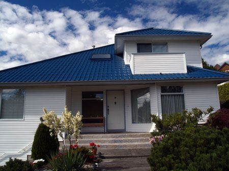This Beautiful Royal Blue Roofing Make The House Come