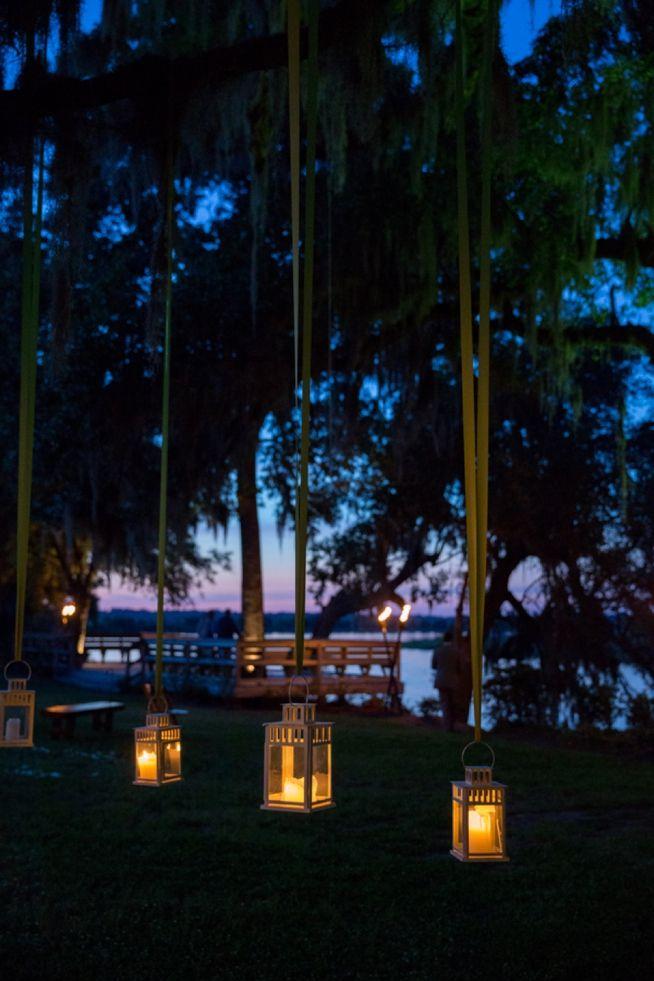 Mood lighting, hanging lanterns // Magnolia Plantation wedding   Real Weddings   The Wedding Row