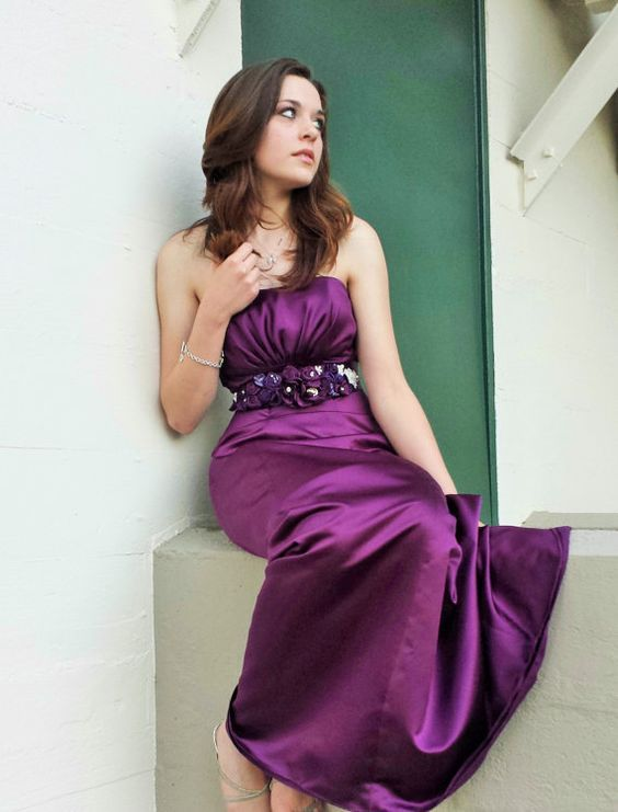 Lady looking very stunning, lovely, and pretty in her lovely and beautiful flower-draped purple dress with lovely flower/corsage belt/beaded sash.