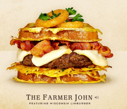 THE FARMER JOHN – If you spend your days baling hay, milking cows, or plowing fields, you know a thing or two about working up an appetite. Good thing for The Farmer John. Standing strong with a bevy of hunger-satisfying fixings, The  Farmer John is for anyone who ends the day with calloused hands and a sweaty brow. – THE TOPPINGS & FIXINGS: Wisconsin Limburger Cheese, Beef Patty,  Bacon, Onion Rings, and Hash Browns on White French Bread Slices with Parsley Garnish.