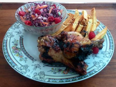 #Barbeque is a great way to #cook. This #meal has 3 #chicken legs. The #grilled #chicken is treated with a #pomegranate #marinade. #Frenchfries from #russet #potatoes are soft inside with a nice #crisp on the outside. This special #slaw is #homemade with finely #shredded #redcabbage, #diced green and orange #bellpepper, and little shredded carrot and #parsley. #saladdressing is with pomegranate #vinegar + #mayo.  Freshly picked, in-season #raspberries add a #sweet #tang to the plate.