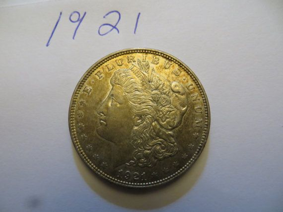 This is a nice looking coin. 1921 Morgan Silver Dollar. No coin dealer but acquired a small collection of Silver Dollars, nicer looking coins then most so check picture and grade this coin for yourself. Free shipping for the lower 48 states only. Please check pictures for