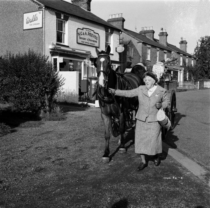 Margaret Rutherford as amateur sleuth 'Miss Jane Marple' on location at Amersham during the filming of 'Murder at the Gallop' in 1963  [... based on Agatha Christie's 1953 novel 'After the Funeral' - although the film changes both the action, and the characters. The original novel featured Hercúle Poírôt rather than Miss Marple, and Christie's trademark suspense was replaced by light comedy. ]