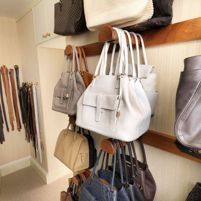 Purses! A purse rack for a walk-in. Awesome touch.