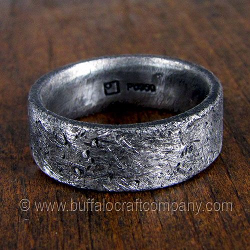 """Rustic Ring"" palladium men's wedding band Inspired by a lifestyle, a new scuff or scratch will only add to the beauty of this ring. It's rough, rustic, and distressed. This men's wedding band is 7mm wide, and is hand fabricated from palladium with a comfort fit interior."