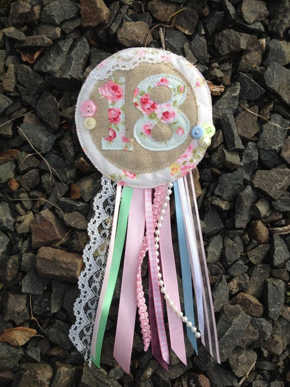 This rosette is made to order, it can be made with any number on it. My rosettes can be made for any occasion...hen party, weddings, birthdays,
