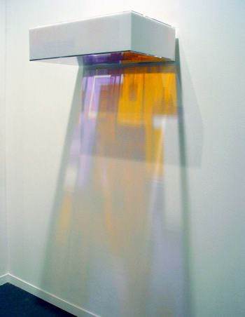 "Won Ju Lim, ""Kiss T2"", 2005, environmentally lit, colored Plexiglass casts image on wall, 17.8 x 243.8 x 43.2 cm."