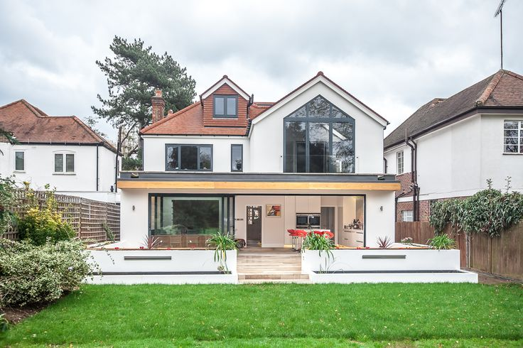 50 Degrees North Architects two-storey side and rear extension in South West London. Open-plan kitchen diner with large sliding doors and unique backsplash
