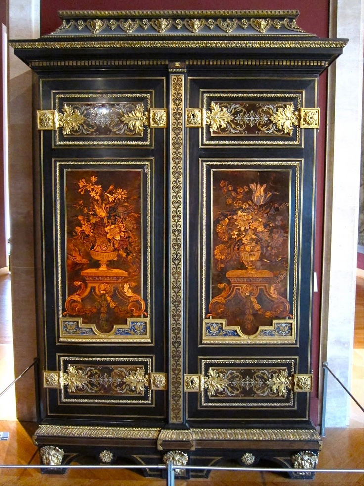 This lush marquetry (inlaid wood) panel is mounted on a French armoire, ca