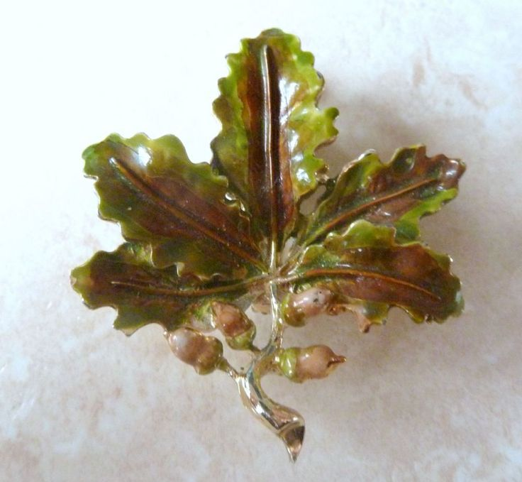 Oak leaf and acorn brooch by Exquisite.  The brooch is formed from vibrant cold painted enamel onto gold tone metal.