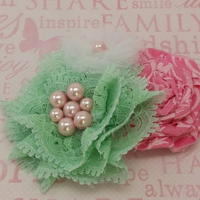 This beautiful hair clip has 3 handmade flowers. The green and white flowers are embellished with pink pearl beads. This is a lovely addition for Women or children and these flowers are placed adhered to a lined alligator clip. #buynow for $14.95 at inselly.com
