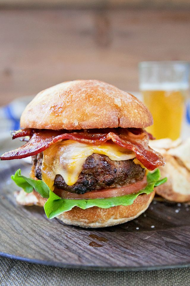 This Bourbon Bacon Burger recipe is the juiciest, tastiest burger you'll ever make. Top with a zesty sauce, Colby jack cheese and caramelized bourbon bacon!