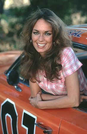 """CATHERINE BACH (Catherine Bachman) Monday, March 01, 1954 - 5' 8"""" - Warren, Ohio, USA. [Daisy Duke] with a General Lee car"""