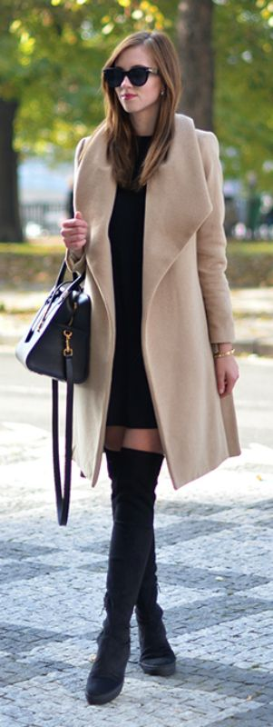 Barbora Ondrackova wears a black mini dress and a camel overcoat with a pair of over the knee boots. Dress: Topshop , Coat: Mango, Boots: Stuart Weitzman, Bag: Saint Laurent.