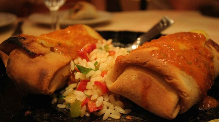 Chimichanga - The Famous Chimichanga, created in 1922 by a voluptuous Mexican cook. Treasured by all but mostly Mac.  She accidentally dropped it in to the deep fryer, as a result the word was created as slang meaning boiled monkey.