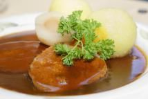 Sauerbraten, marinated beef, with dumplings - Wilfried Krecichwost/Photodisc/Getty Images