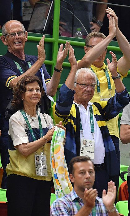 Queen Silvia and King Carl Gustaf got on their feet to cheer for the Swedish Handball team during the Preliminary Group B match against Brazil.