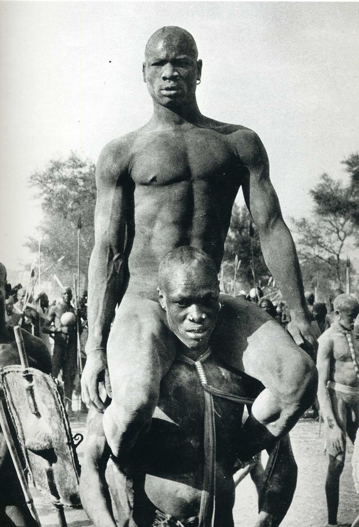 George Rodger. Sudan, Kordofan. The Nubas 1949 (The image of the wrestler being carried victorious was taken in 1949 by George Rodger; a Briton and prolific World War II photographer. He was the first man to photograph inside the infamous Bergen-Belsen concentration camp, after it was liberated from German control..)