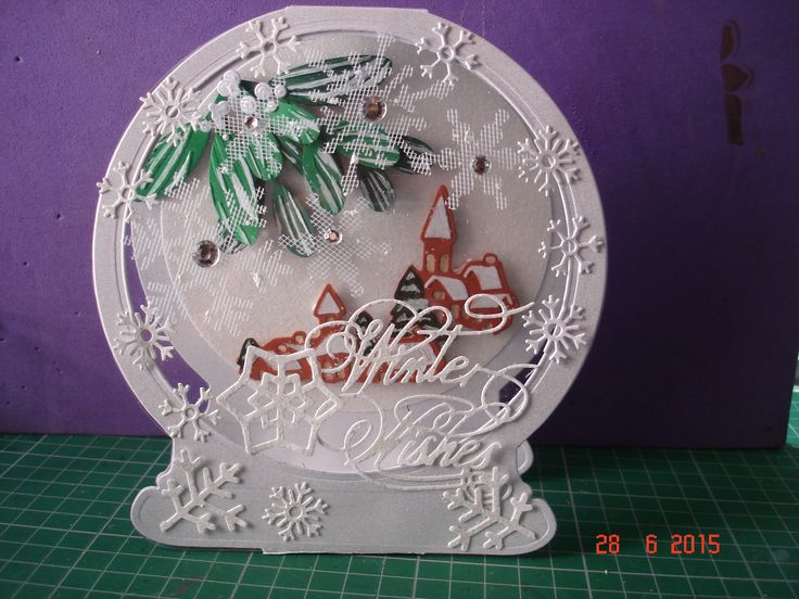 My first card made with The Tattered Lace Snow Globe die and the TL Mistletoe Trio. I also used the village dies from Marianne Designs.