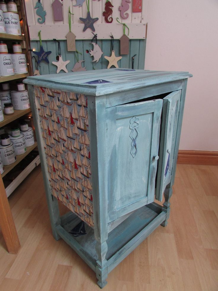 Old cupboard,formerly dark wood, distressed in a province and old White and some lovely sailing fabric, finished with soft clear wax