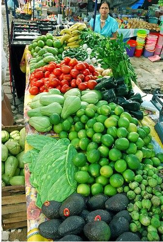 Vegetables in a Mexican market - Aguacates, tomates, limones, nopales, chayotes, etc. Mexico