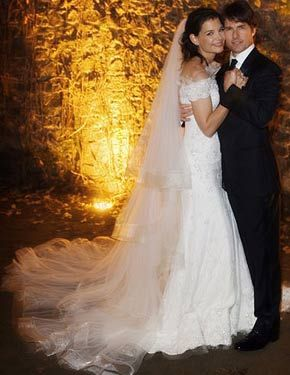 Giorgio Armani created a fitted off-the-shoulder gown for Katie Holmes on her wedding day to Tom Cruise.
