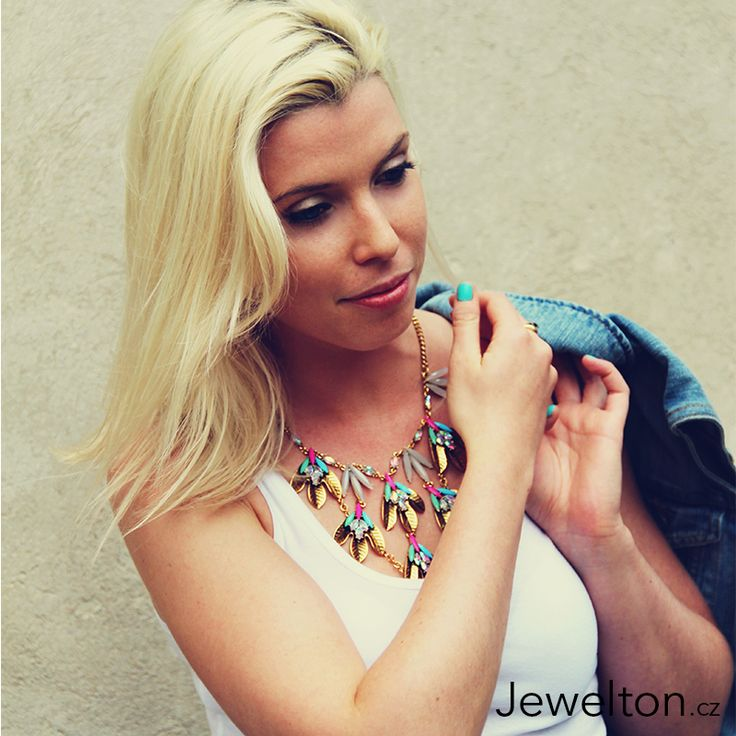Blondie girl with a beautiful necklace and classy blue jeans jacket :)