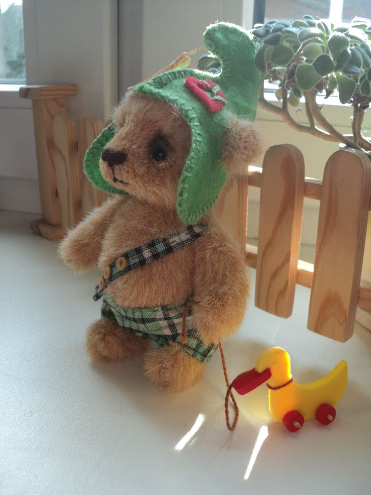 Handmade bear cub with his toy duck