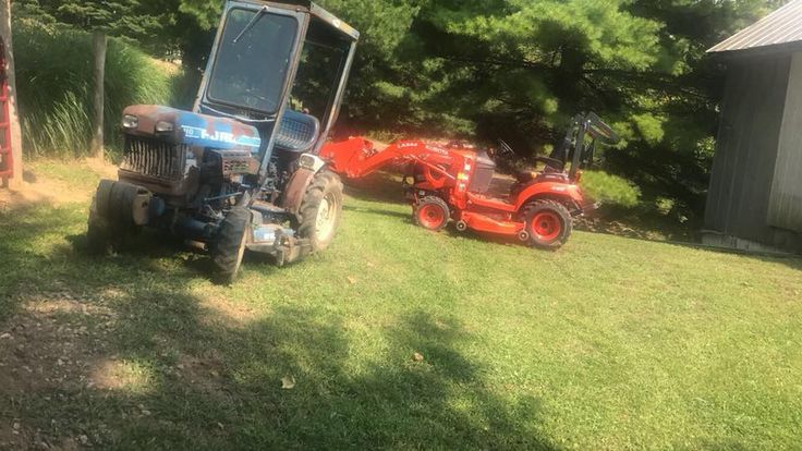 Ford 1210 & a Kubota compact tractor