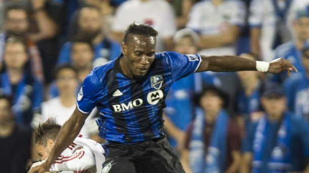 Montreal Impact forward Didier Drogba heads the ball in front of D.C. United midfielder Marcelo Sarvas during the second half of an MLS soccer match Wednesday, Aug. 24, 2016, in Montreal. (Paul Chiasson/The Canadian Press via AP)