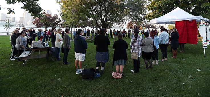 A group forms a circle in Dieppe Park as part of the 11th annual National Sisters in Spirit Vigil for the murdered indigenous women across Canada in Windsor on Tuesday, October 4, 2016. The annual event seeks to raise awareness of missing and murdered women.